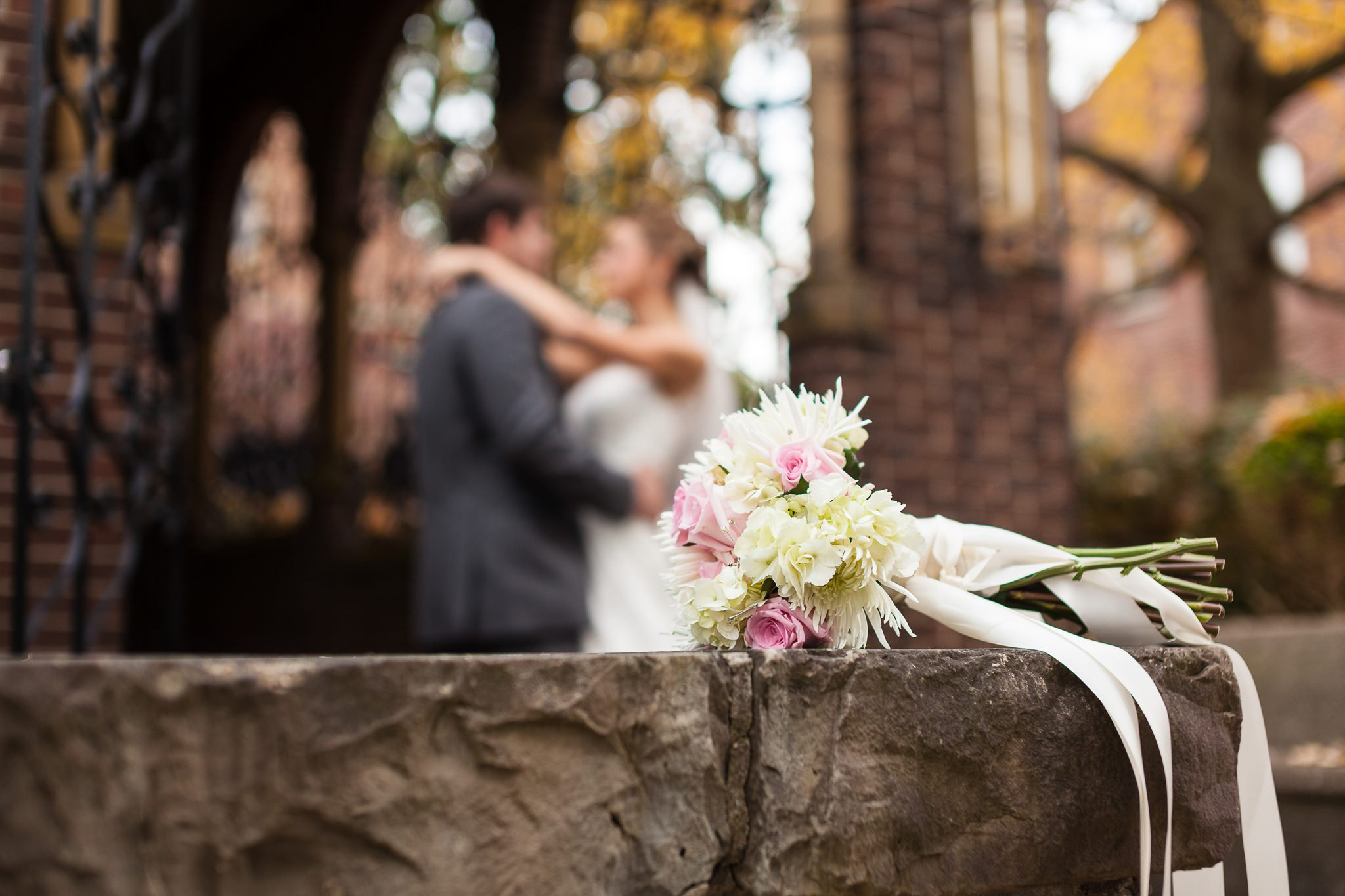Couple with bridal bouquet by Wes Brown Photography